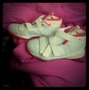 Pink and White Nike shoes